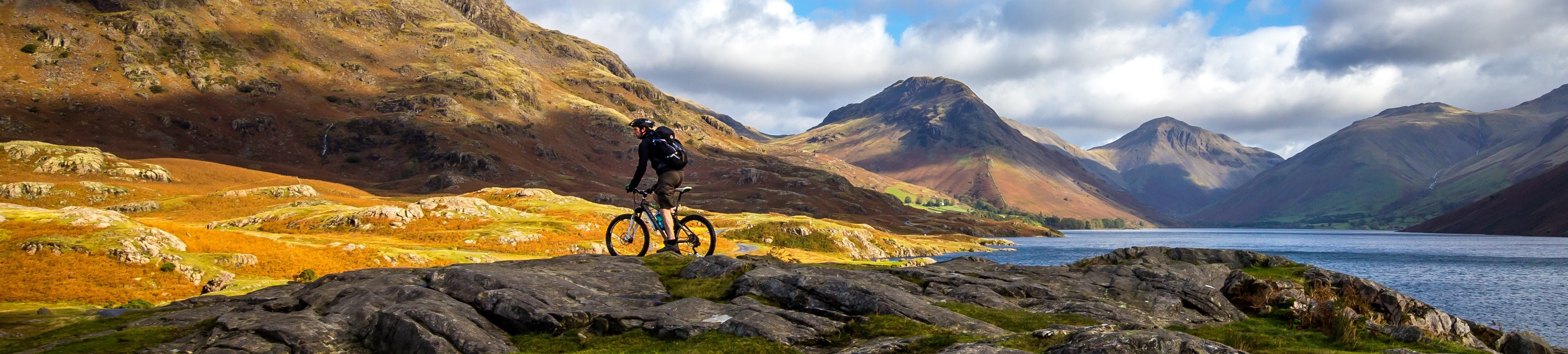 person mountain biking